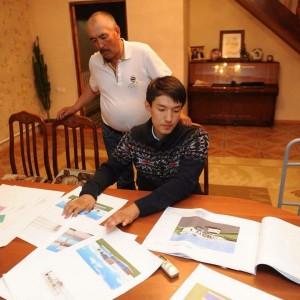 Eldos looks over the architect plans for the new rehabilitation center.