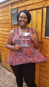 School for Social Entrepreneurs Fellow Rianna Raymond-Williams poses with a copy of her magazine Shine Aloud
