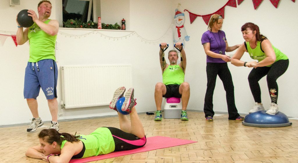 A group of people doing various exercises as part of a Bodeeworx session