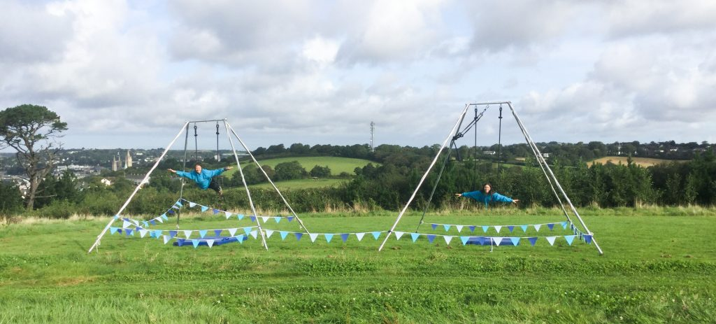 Tree Stewart, on acrobatics apparatus in a field.