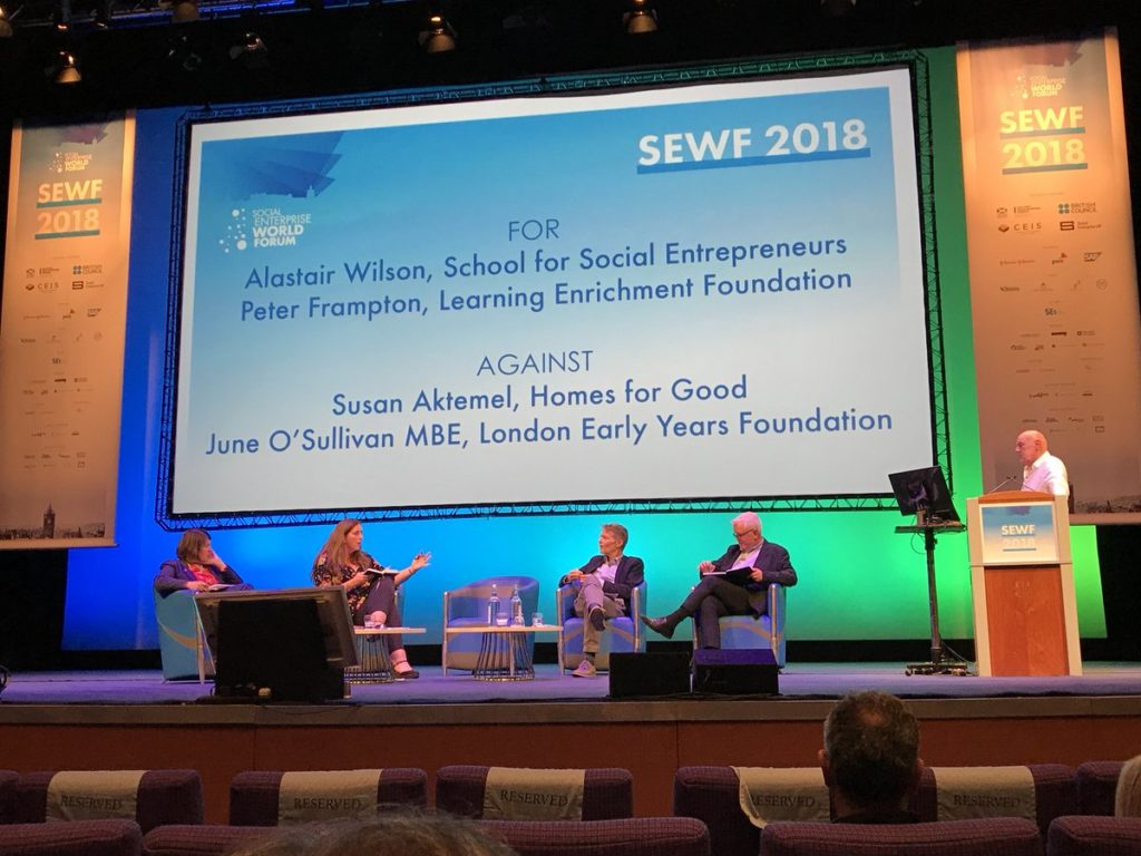 SSE CEO Alastair Wilson debates at SEWF 2018 on a panel with others on stage
