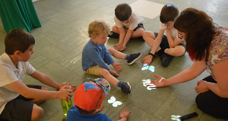 A group of children playing with an adult facilitator