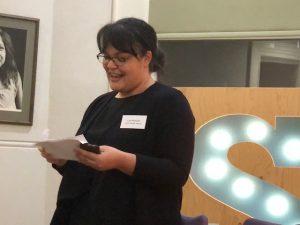 A photo of Lisa Mairah making a speech