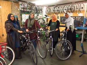 four women with bikes
