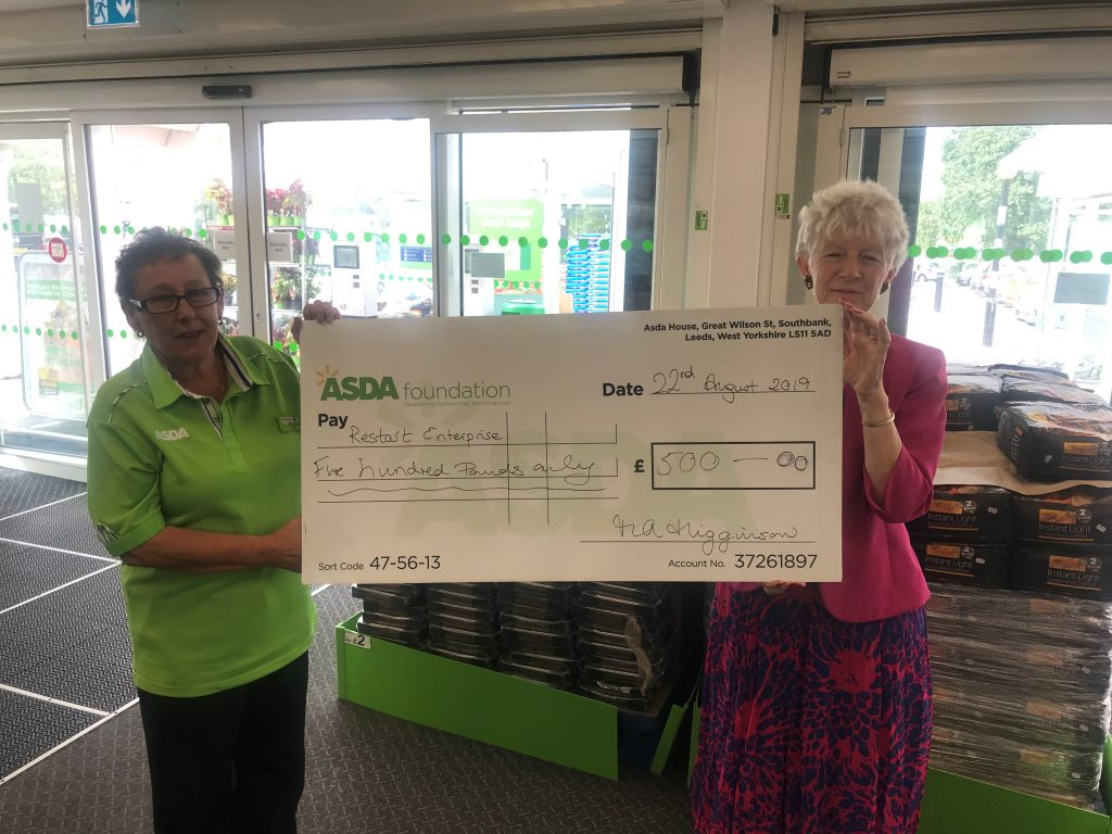 Maureen (left) who is Asda's Community Champion presenting a £500 cheque to Penny (right) - a volunteer and now a director of Restart.