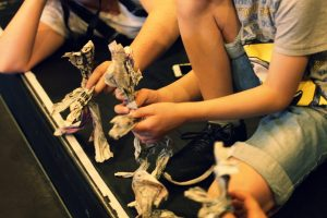Childrens hands doing arts and crafts at Blue Cabin
